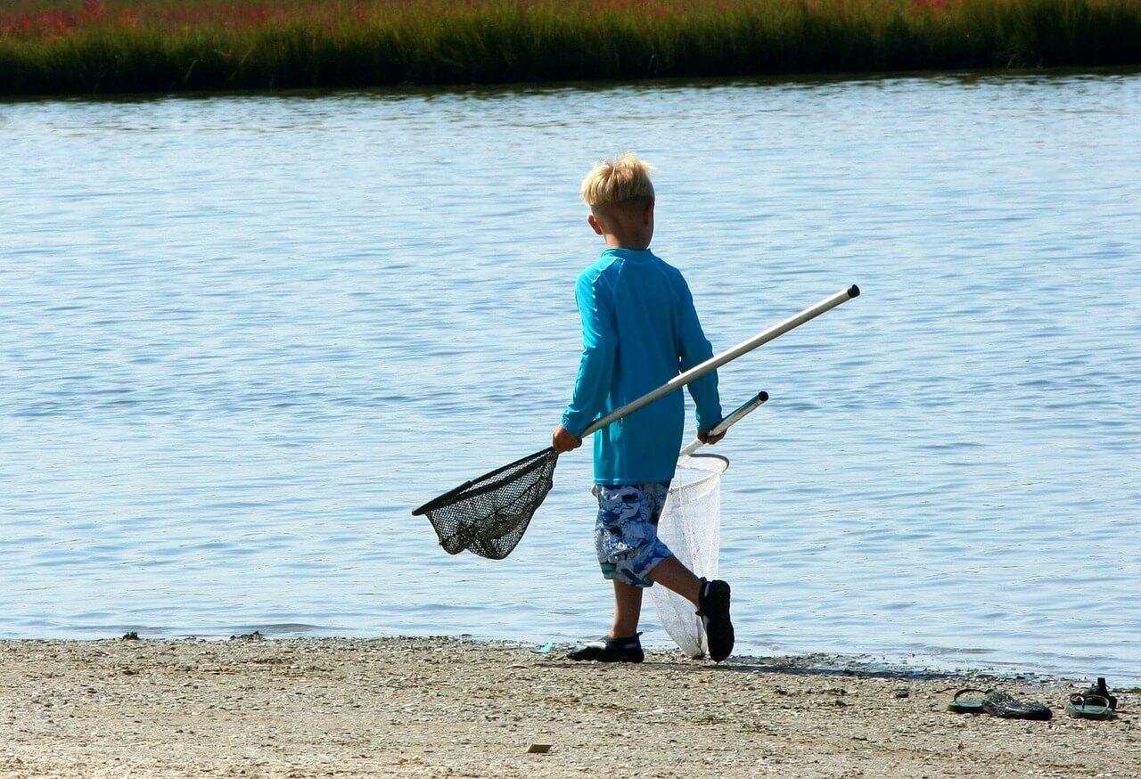 Boy crab fishing