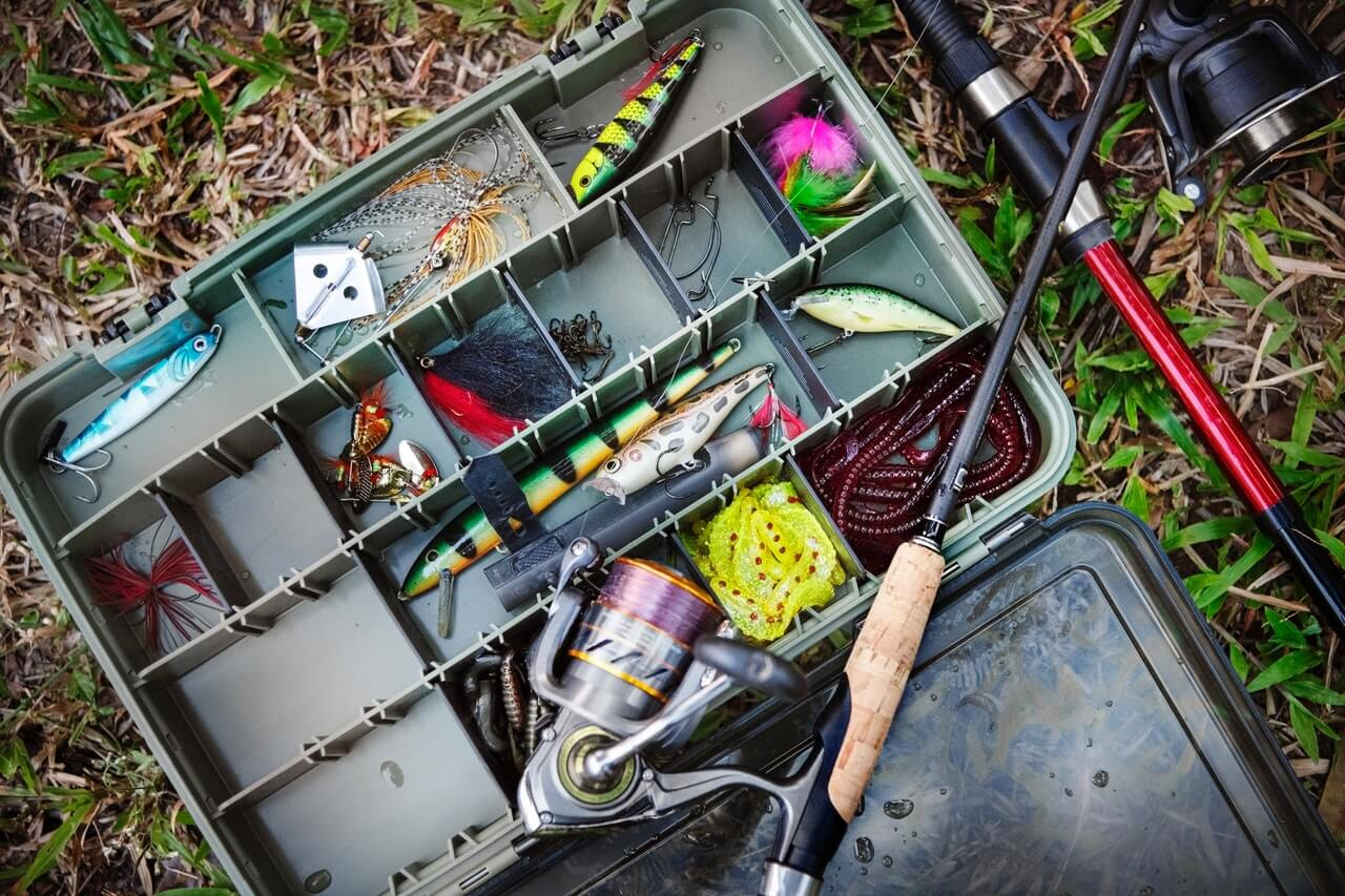 tackle box with fishing lures and rods