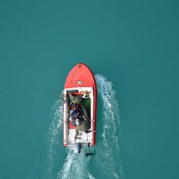2 fishermen fishing in boat