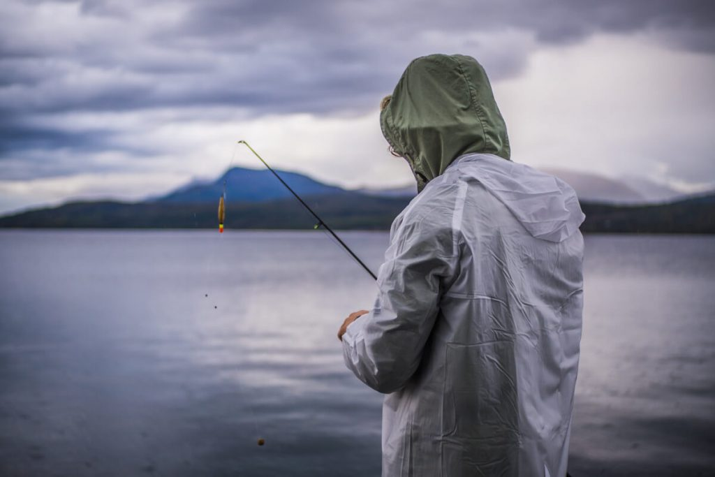 fisherman wearing rain coat