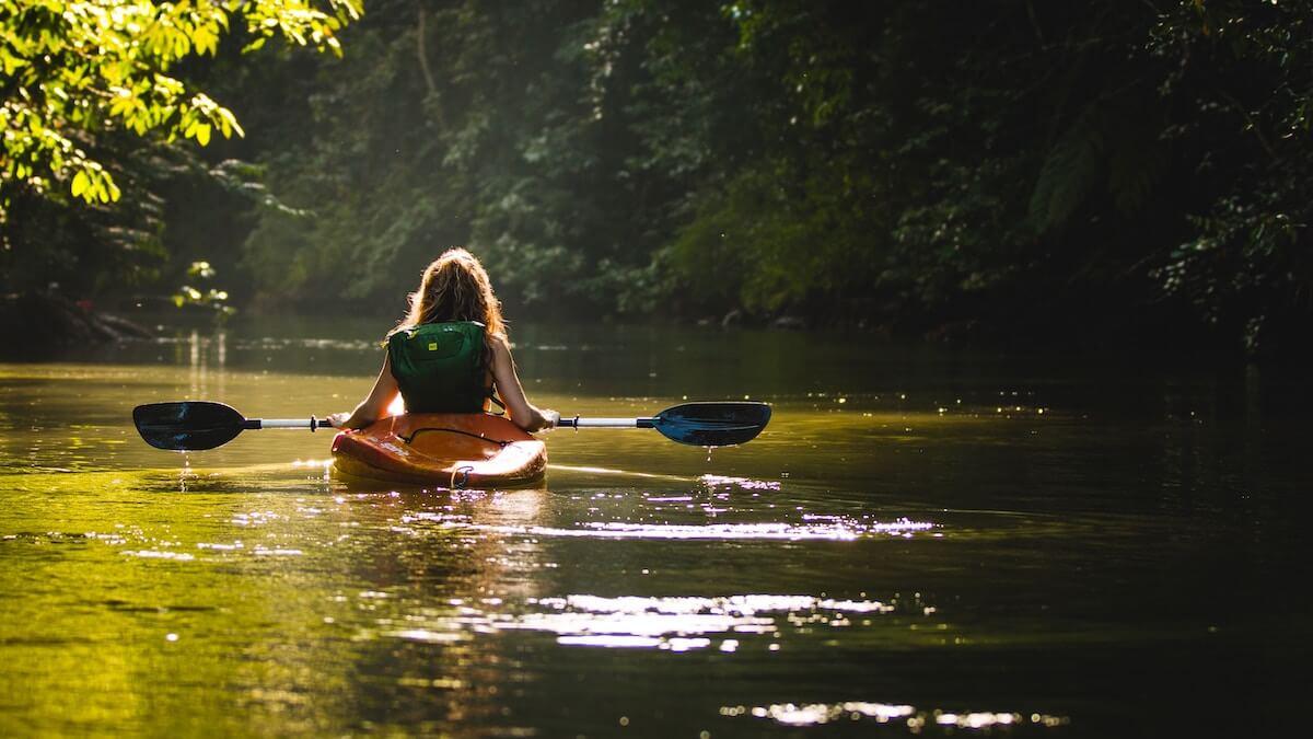 girl in kayak in river