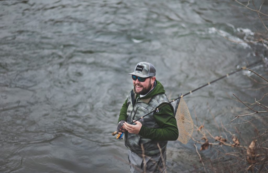 man in fishing vest