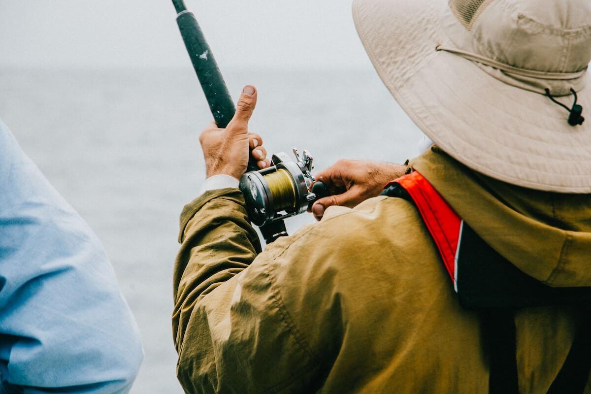 man in jacket fishing