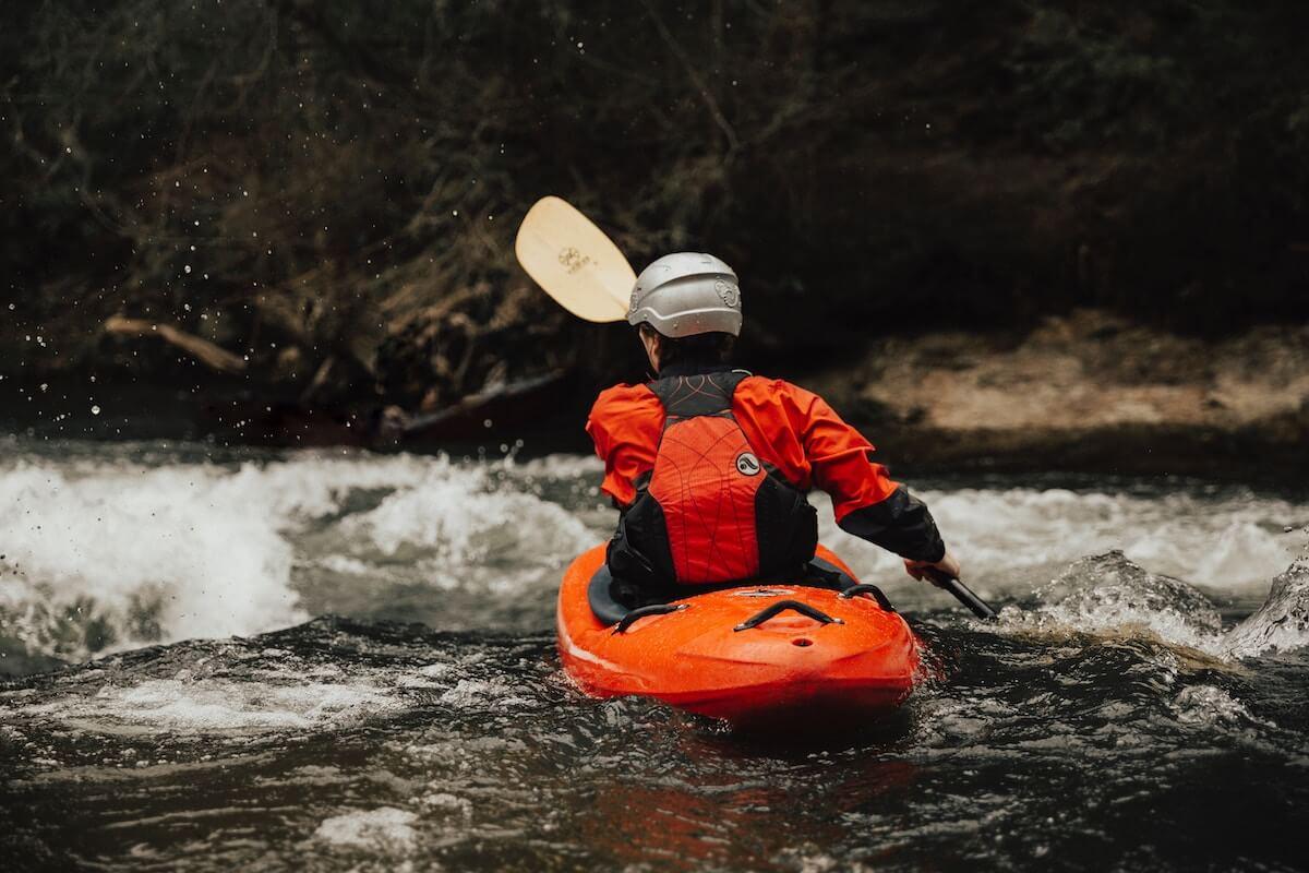 man in kayak in river