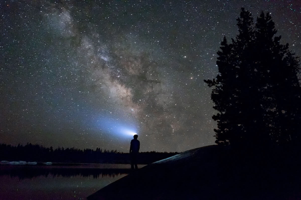 man near lake in night