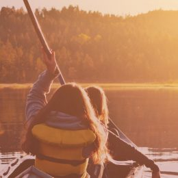 two girls in kayak in sunset