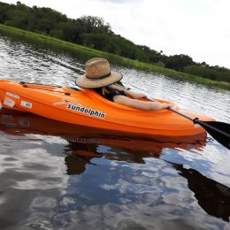 women sleeping in kayak