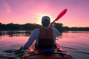 man kayaking with lifejacket on