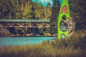 man preparing for kayak fishing trip