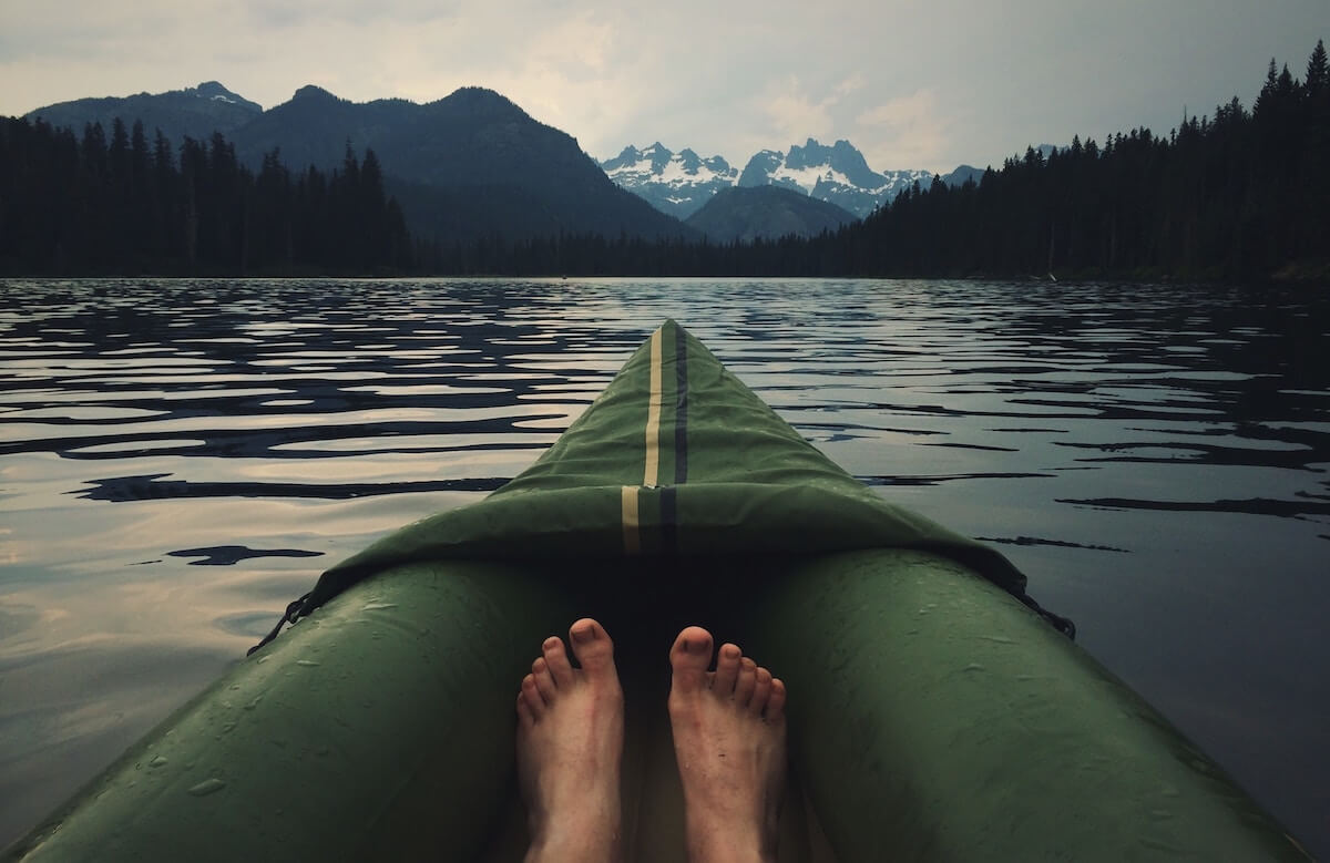 persons feet in a green kayak