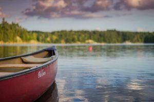 red canoe in lake