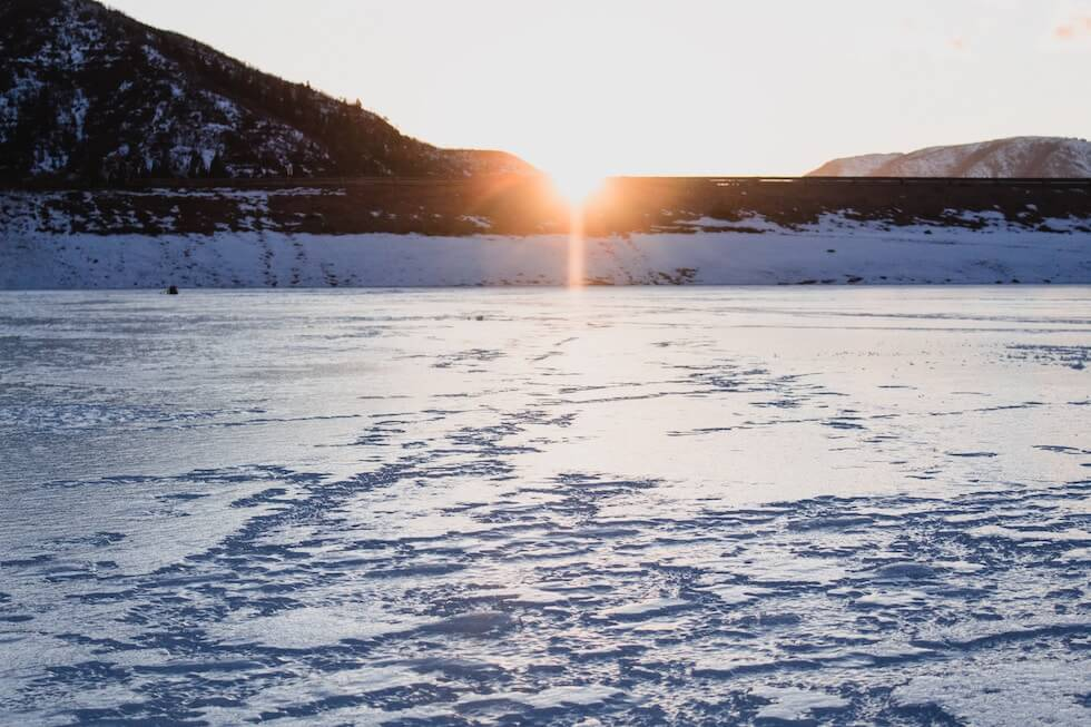 sunrise on frozen lake
