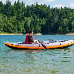 woman kayaking in inflatable tandem kayak on lake